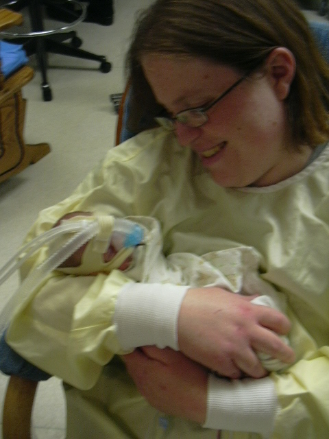 Me holding Daniel for the first time on April 25. 2009.  He was almost 3 weeks old and just off the ventilator.